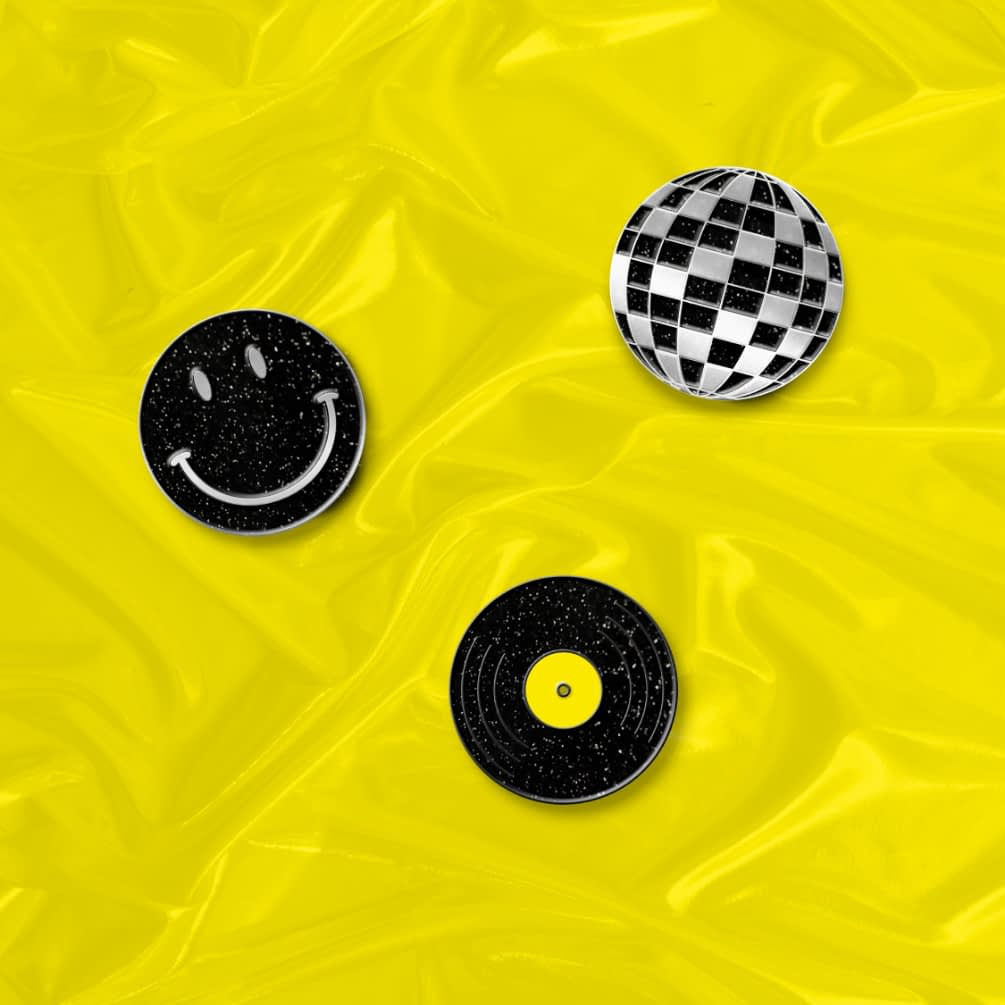3 Pin badges on yellow background